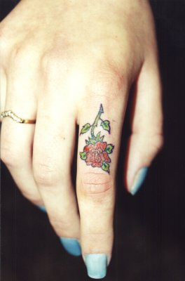 small red rose tattoo on finger. Black Bedroom Furniture Sets. Home Design Ideas